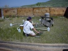 Researcher adjusting equipment